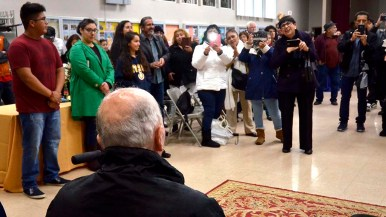 Parishioners at Our Lady of Guadalupe Church greet Fr. Richard Brown, who was pastor at the church for 37 years.