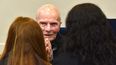 The Rev. Richard Brown speaks with two young women who visited with him at his farewell dinner.
