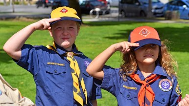 Laura Hutto (left) and Evangelina Rodgers practice their Scout salute.