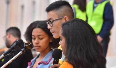 Students speak against gun violence to a crowd of thousands.