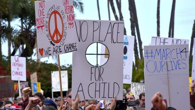 Many marchers brought homemade signs to the downtown San Diego protest.