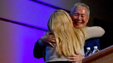 Actor-activist George Takei hugs Associated Students President Lesly Figueroa before his talk at UC San Diego.