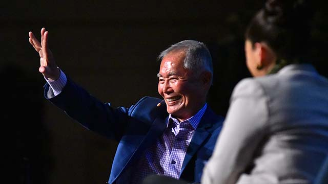 Actor-activist George Takei gives a Vulcan salute to Star Trek fans during a UC San Diego talk.
