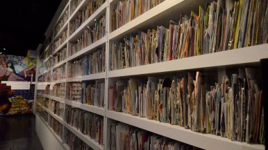Postcards and letters that Frank Warren has received during his PostSecret project is stacked on shelves at the Museum of Man exhibit.
