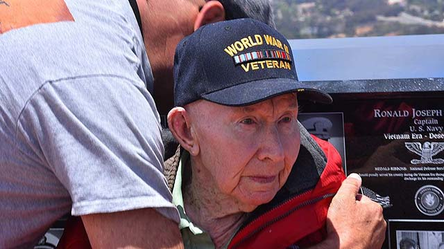 Joe Reilly, a member of the 101st Airborne Screaming Eagles, is hugged for his service at Mount Soledad National Veterans Memorial.