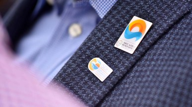 Vincent Mudd of the local games organizing committee wore two pins of the inaugural games. Other pins are expected, plus trading.