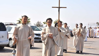 A procession at the Jesuit ordination begins at Our Lady of Mount Carmel Catholic Church in San Ysidro.