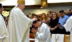 San Diego Bishop Robert McElroy blesses O. Alejandro Baez-Gonzalez during the ordination.