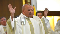 Newly ordained Jesuit priest Elias Puentes concelebrates during the Mass.