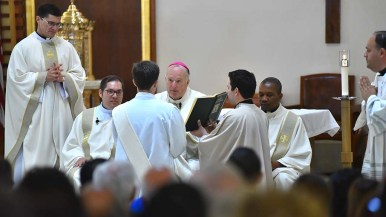 San Diego Bishop Bishop Robert McElroy speaks with Thomas Flowers during the ordination at Our Lady of Mount Carmel in San Ysidro.