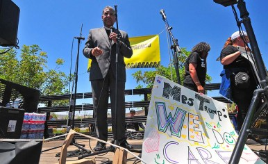 PICO National Network director Alvin Herring speaks to the crowd in front of the detention center.