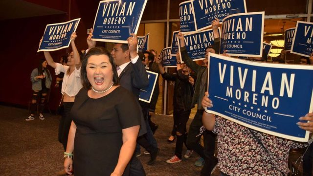 Leading District 8 San Diego City Council candidate Vivian Moreno arrives with supporters at Golden Hall, including Councilman David Alvarez.