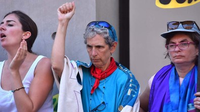 Rabbi Shifrah Tobacman of the San Francisco Bay Area (center) responds to a speech in downtown San Diego.