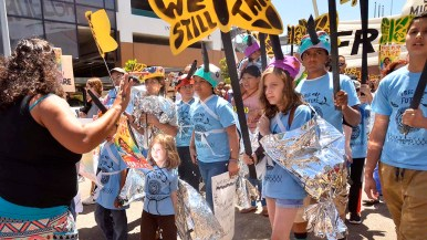 Children, some draped in mylar blankets, led the march down National Avenue toward downtown.