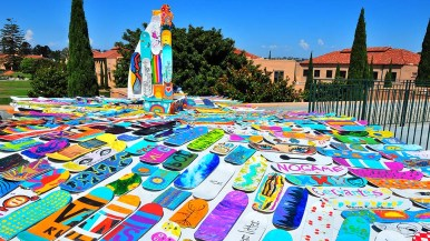 """""""Rolling it Forward"""" on the roof of Building 202 represents a boat and rolling waves made entirely of community-painted skateboards."""