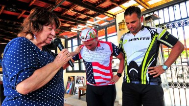 A member of the Republican group prays for the safety of the two candidates who bike to their events.