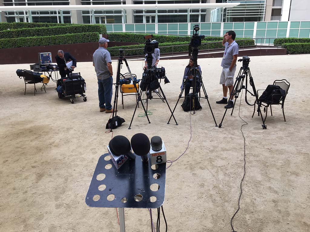 TV crews, including from Los Angeles set up for any press conference on the Hunter indictments near entrance to federal courthouse.