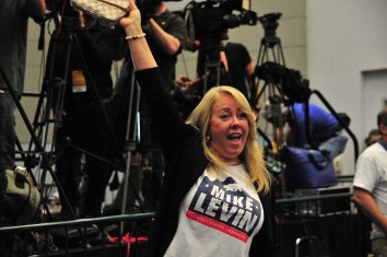 Sherry Vandervoort, a volunteer for congressional candidate Mike Levin , cheers as she enters the ballroom.
