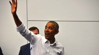 Former President Barack Obama waves goodbye to supporters at a rally for congressional candidates.