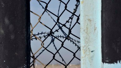 In addition to the posts and chain-linked fence, concertina wire was recently installed at the border.