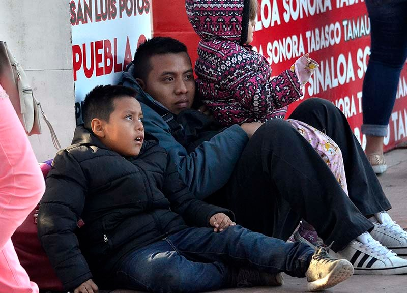 A family at the San Ysidro Port of Entry waits for entrance into the United States.