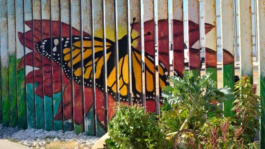 Some colorful murals have been painted on the Mexican side of the border fence.