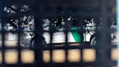 A Border Patrol truck sits near the border on the U.S. side.