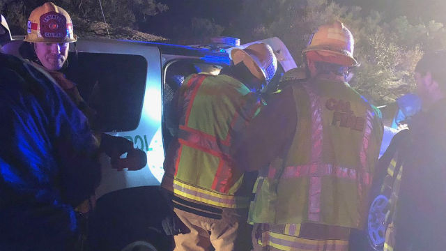 Cal Fire personnel at the second of the triple fatality on Interstate 8