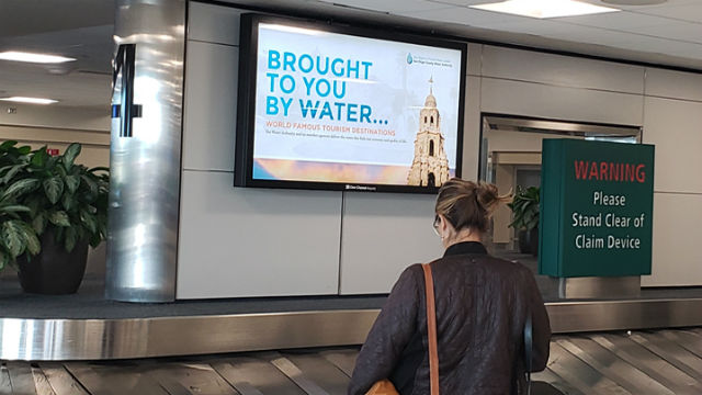 """""""Brought to You by Water"""" campaign on airport monitor"""