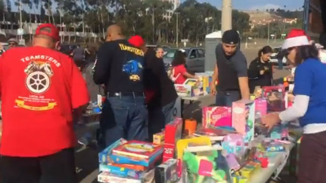 Volunteers at food and toy distribution