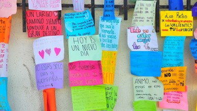 """Messages such as """"Today is a new day,"""" """"You are not alone. God is with you,"""" """"A long road always leads to great destiny"""" are posted near the entrance to the shelter."""