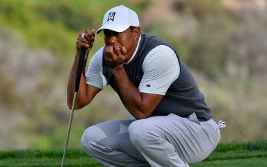 Tiger Woods puzzles out a putt on Day 1 of the Farmers Insurance Open.