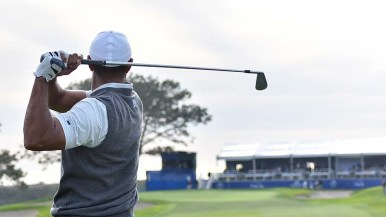 Tiger Woods looks for the green on Day 1 of the Farmers Insurance Open.