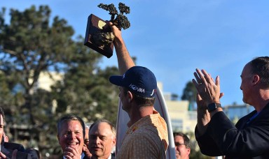 Justin Rose raises his trophy for the crowd to see after winning the Farmers Insurance Open, shooting 21 under par on Jan. 27, 2019.