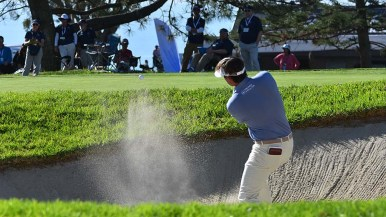 Hank Lebioda shoots out of a sand bunker on the 15th hole of the Farmers Insurance Open on the Torrey Pines Golf Course.