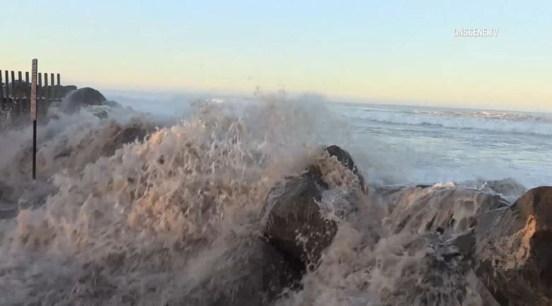 Waves flood a low-lying area of Imperial Beach