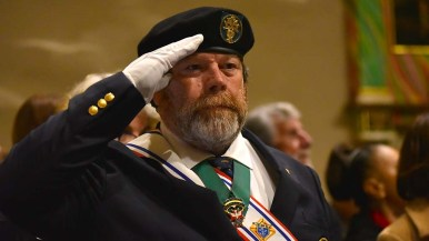 A member of the Knights of Columbus stands at attention for the opening processional.