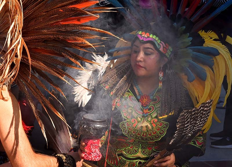 A member of the Kumeyaay Native American tribe performs a smudging blessing before the march.
