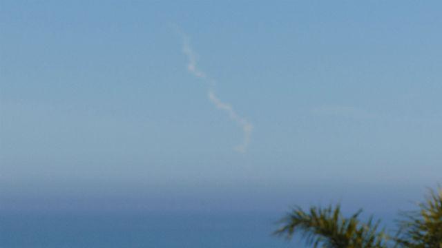 Vapor trail of Delta IV Heavy rocket