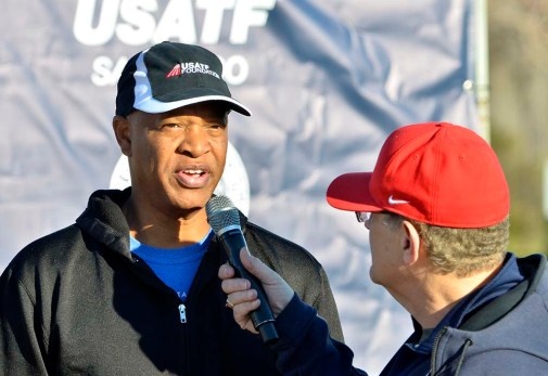 Race director Tracy Sundlun interviews Willie Banks of Carlsbad, America's new representative to the governing body IAAF.