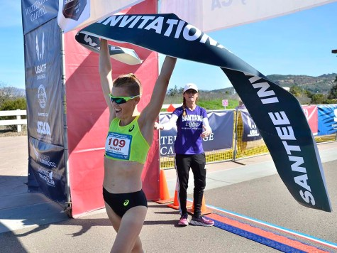 Claire Tallent raises finish tape after smashing Santee 50K course record by 9 minutes.