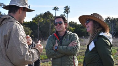 Supervisor Nathan Fletcher (center) and Edie Munk, whose family once owned the land, talk with marsh tour leaders.