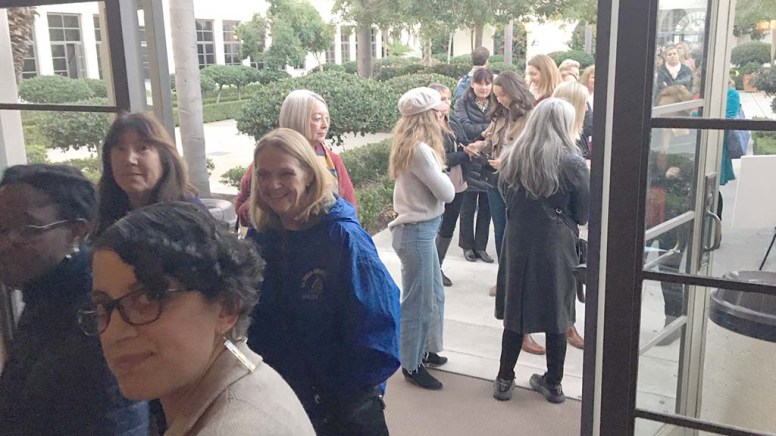 Hundreds lined up to show their printouts at Shiley Theatre, which bought them a book and a seat for Chelsea Clinton reading and Q&A.