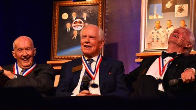 Sharing a laugh on stage before nearly 500 patrons were (from left) Jim McDivitt, David Scott (one of four living moon-walkers) and Rusty Schweickart.