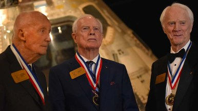 Posing in front of the Apollo 9 command module that 50 years ago landed close to an aircraft carrier were (from left) Jim McDivitt, David Scott and Rusty Schweickart.