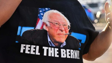 A Bernie Sanders supports wears his version of the Fell the Bern slogan on his t-shirt.