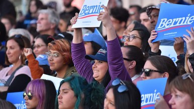 Sen. Bernie Sanders's supporters stood on the steps behind him and cheered his agenda.