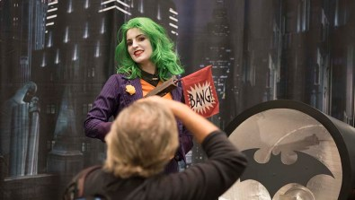 A photographer gets an image of Fernanda Ceron of Brazil in her Lady Joker cosplay.