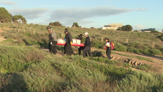 San Diego Fire-Rescue personnel remove one of the bodies