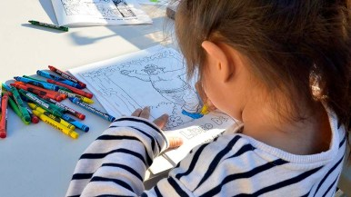 Children have an indoor and outdoor place to play games and color pictures.